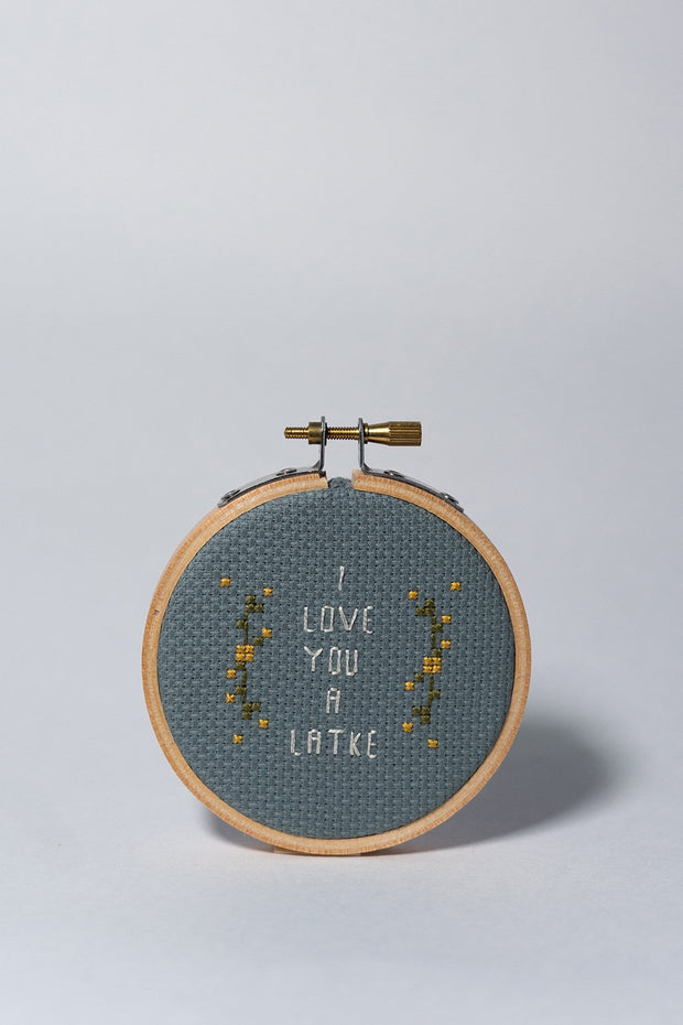 Junebug and Darlin I Love You a Latke Cross Stitch Kit front on white