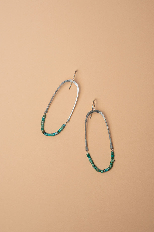 PHD Turquoise Half Oval Earrings on color background