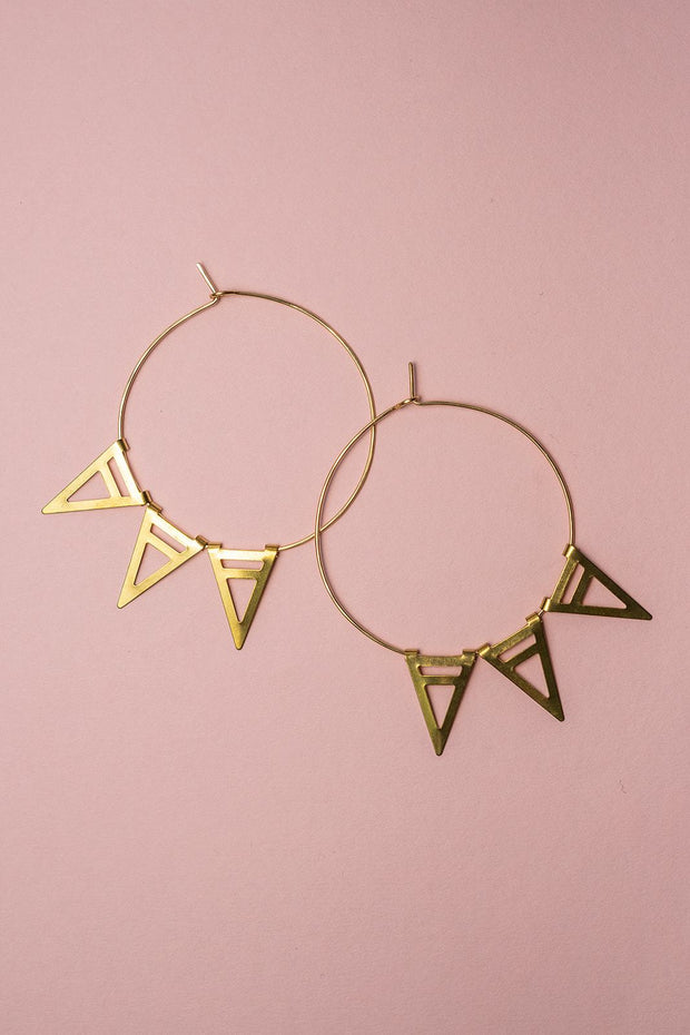 PHD Self-closing hoop with spikes gold on color backdrop