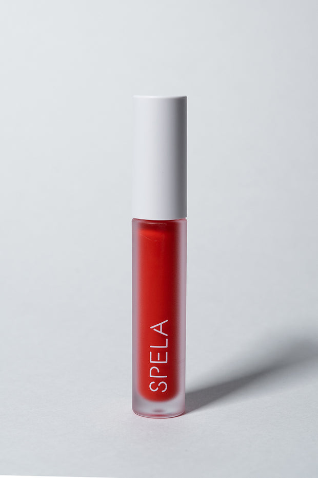 spela tinder lipstick red front grey background