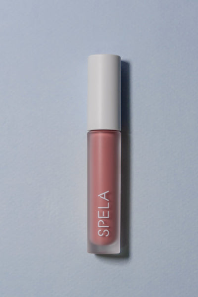 spela flirt lipstick on color background