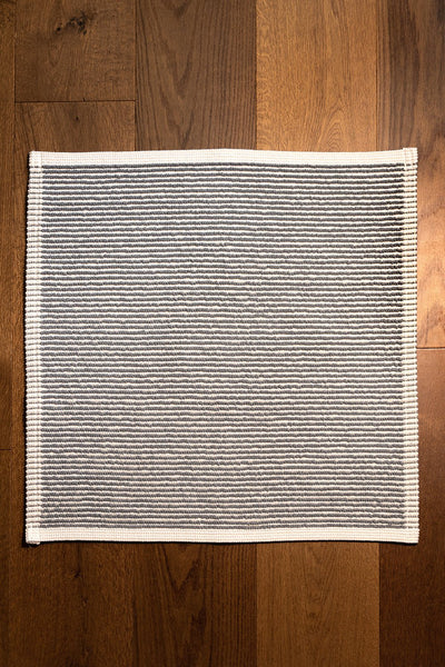 Madison Collection Grey-striped Bath Mat on Wood Floor