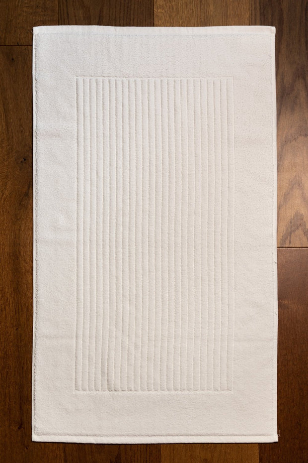Madison Collection Metro Bath Mat on Wood Floor