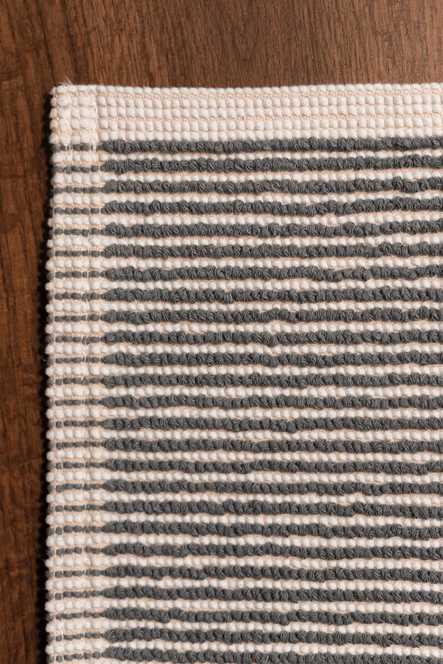 Madison Collection Grey-striped Bath Mat on Wood Floor Detail