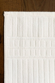 Madison Collection Canelado Bath Mat on Wood Floor Detail