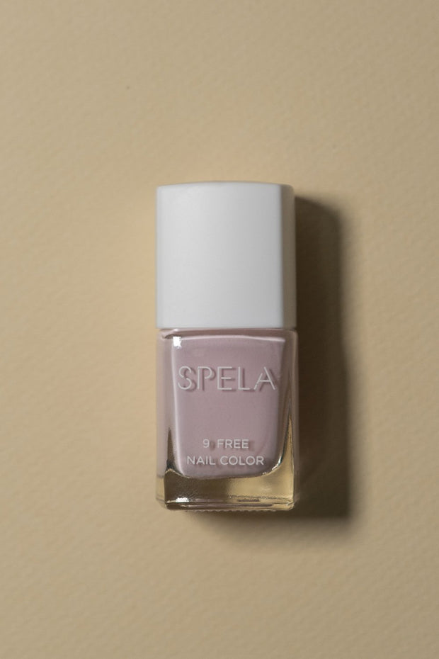 spela pinky swear nail polish on color background