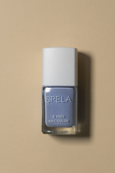 spela blissed out nail polish on color background