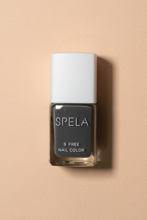 spela nail polish activated charcoal on color background