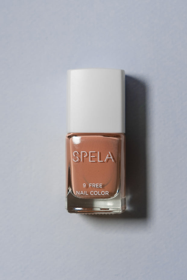 spela skin contact nail polish on color background