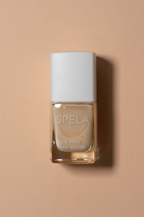 spela moon bath nail polish on color background