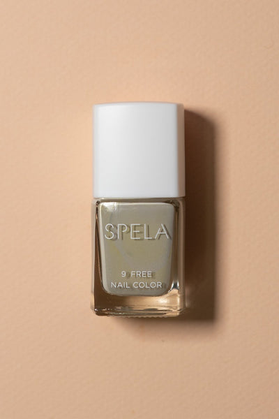 spela goat grey nail polish on color background