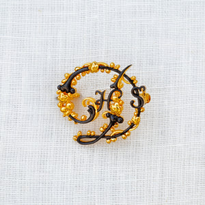 Sterling silver, yellow gold vermeil and rhodium House Style brooch
