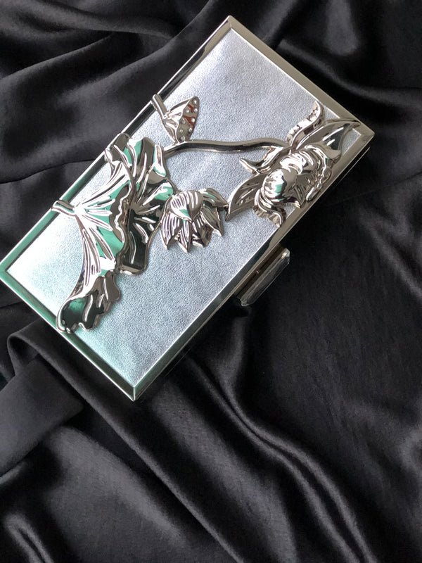 ANJOLA SILVER EMBOSSED CLUTCH