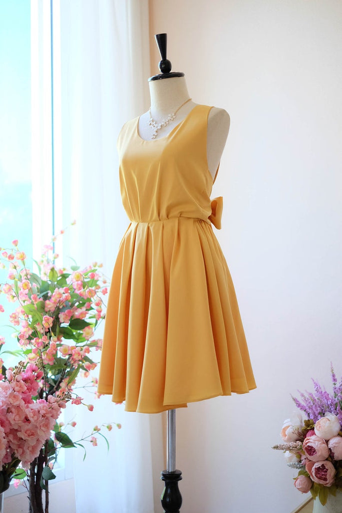 Yellow wedding guest dress