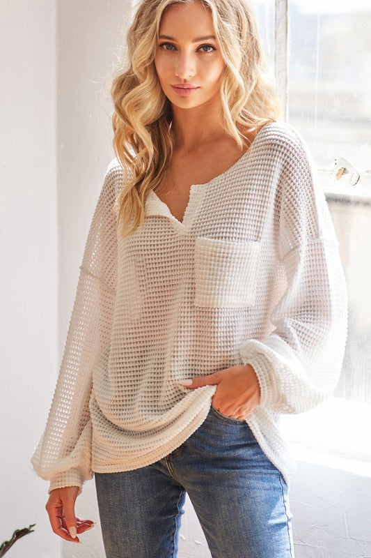 POPCORN WAFFLE KNIT TOP WITH BUBBLE SLEEVES AND FRONT PATCH POCKET