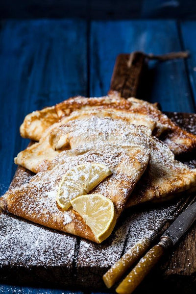 Breakfast in Bed Threads: Traditional French Crepes with Powdered Sugar and Lemon