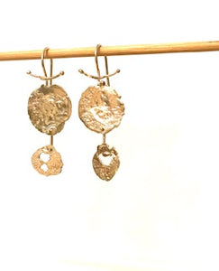 double disc drop earrings are created by Wendolyn Hammer by fabricating each gold discs individually.