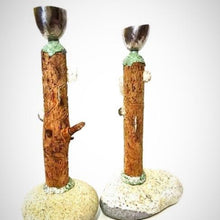 Load image into Gallery viewer, sculptural candlesticks with a rock base wood stem and a bronze candle cup made by Wendolyn Hammer