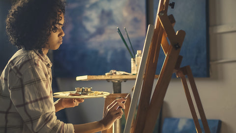 Female Painter Painting on a canvas paint by numbers