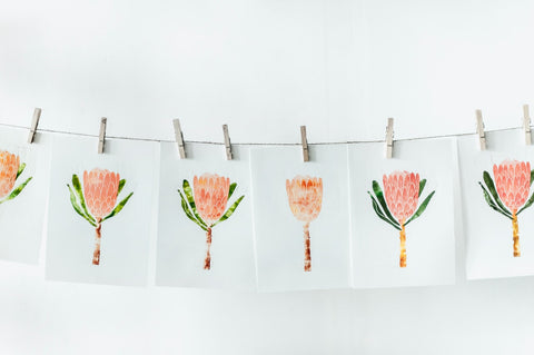 Flowers in Orange and White over white paper hanged