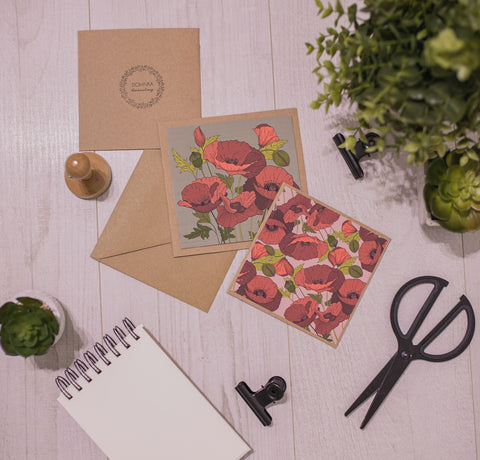Handmade invitation gift card with flowers and stationery near houseplants
