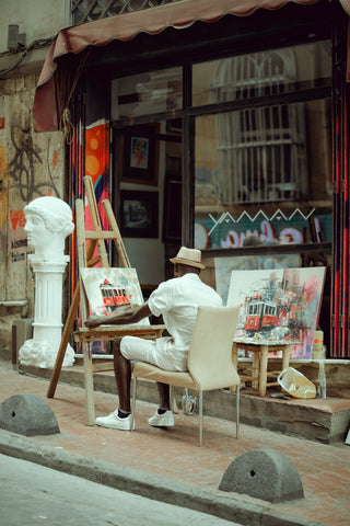 Man painting relaxing outdoors