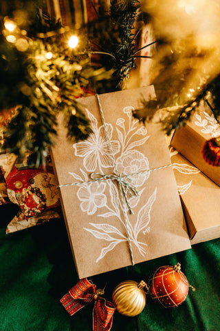 brown card with floral design near christmas tree
