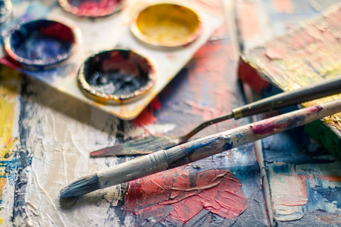 photo of brushes and paints in a pallet