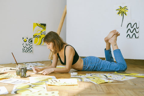 photo_of_woman_lying_on_the_floor_and_painting_to_relieve_stress