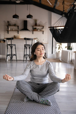 woman practicing yoga and mindfulness