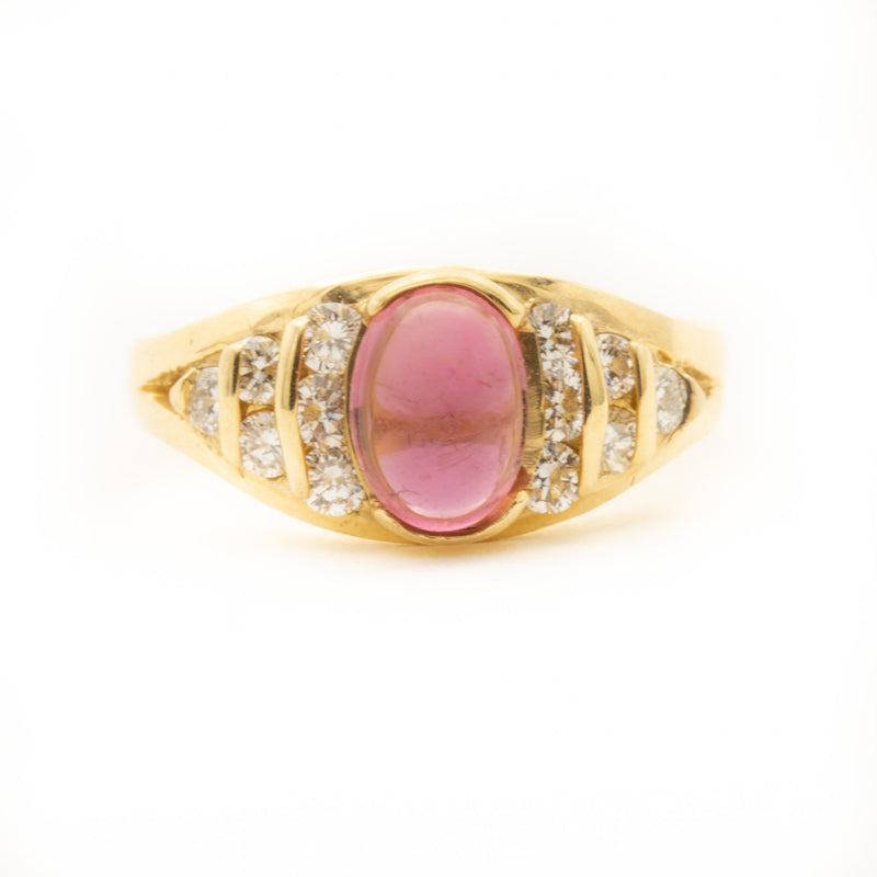 Pink Tourmaline flanked by Brilliant Cut Diamonds