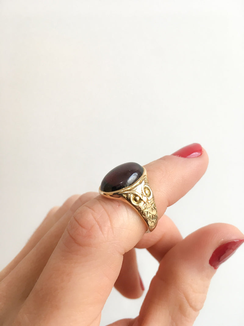 Oval Garnet Ring Flanked by Owls