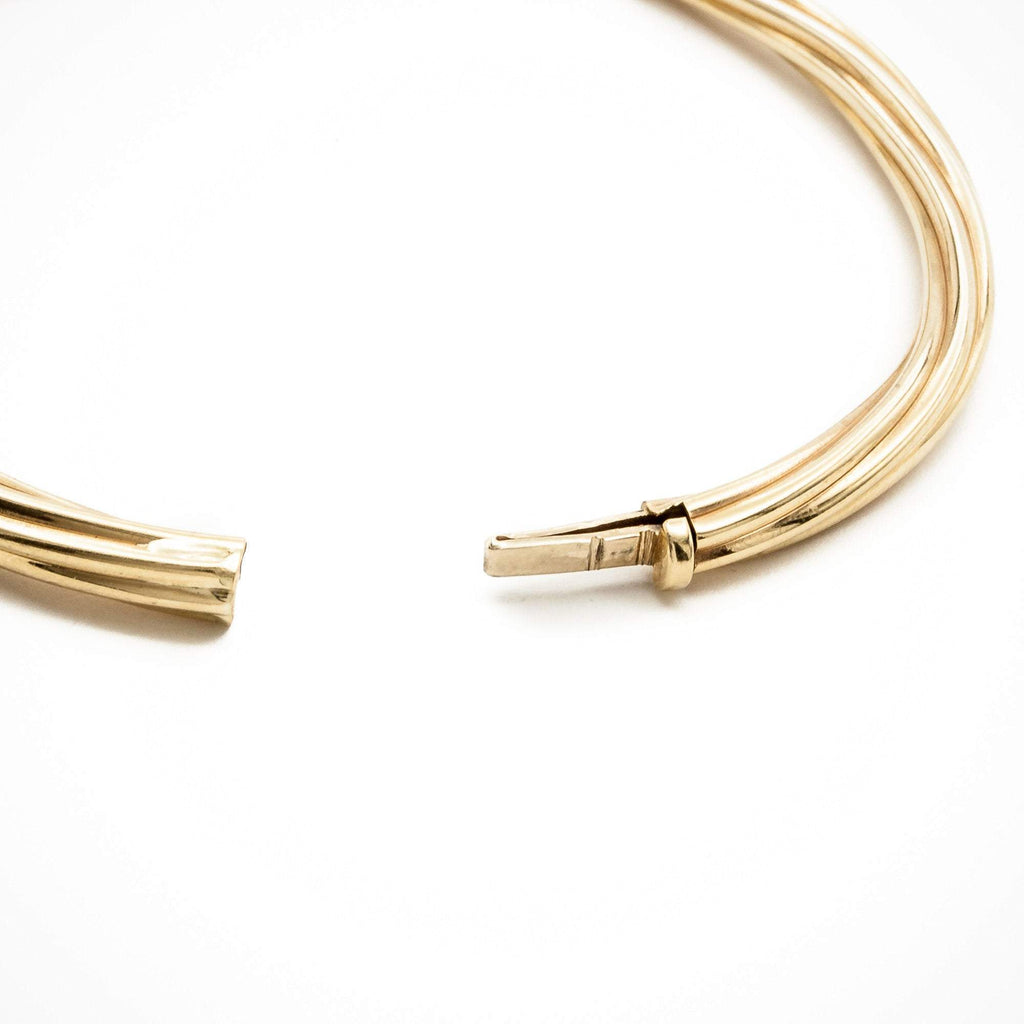 Twisted Strands of Gold Bangle with Double Lock Catch