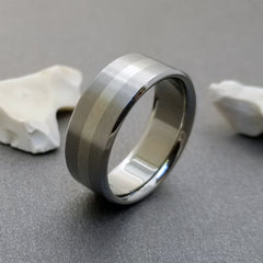 Handmade titanium wedding band, inlaid with one stripe of solid 18k white gold.