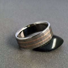 "Beautiful hand ground ""Wood Grain Sequoia"" finished titanium ring in a flat profile, with two narrow solid 18k rose gold pinstripes."