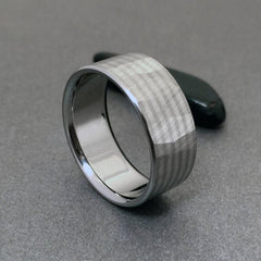 "Handcrafted titanium band, inlaid with four stripes of solid 18k white gold. Faceted with our original ""Wood Grain Sequoia"" finish."