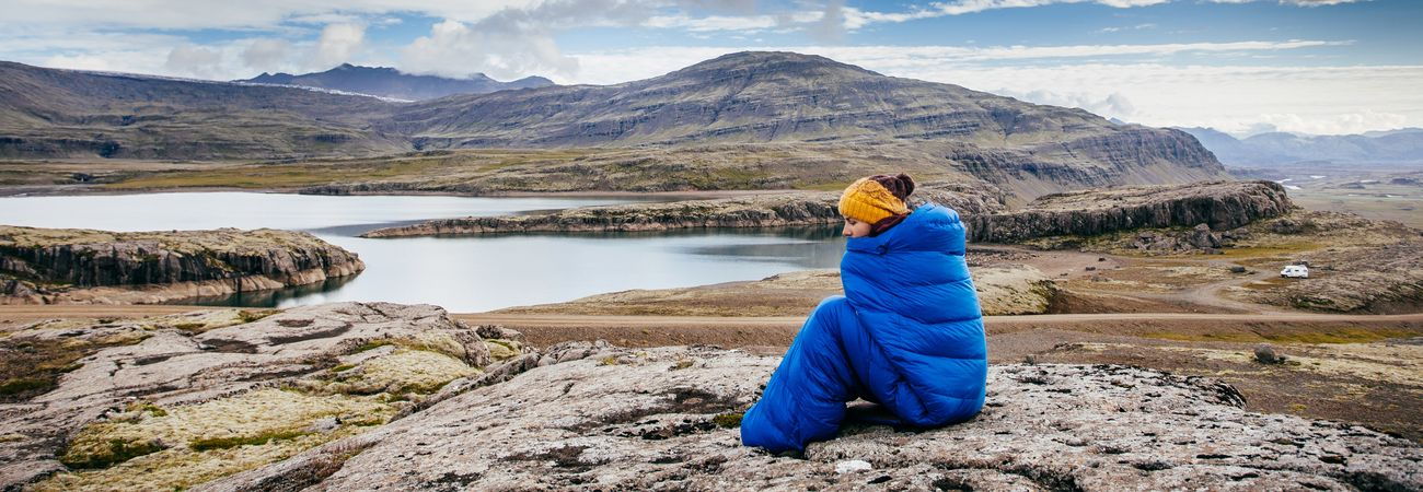 women sleeping bag lake