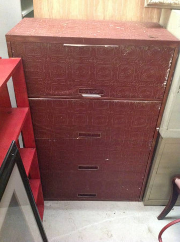 LARGE FILE CABINET COVERED IN RED WALLPAPER