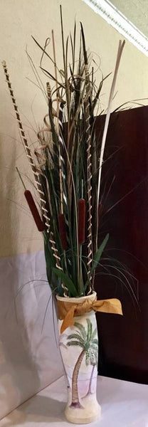 TALL FLORAL ARRANGEMENT IN DECORATIVE VASE WITH PALM AND BOW