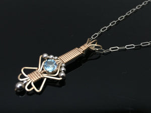 Light Blue Topaz Charm Pendant Argentium Silver and 14 karat yellow gold filled wire wrap designs by Ryan Eure