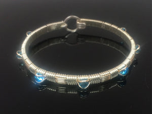 Blue Topaz Wire Wrap Bracelet Argentium Silver and 14 karat yellow gold filled woven bracelet design by Ryan Eure Designs