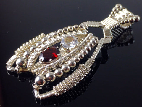 Garnet and Topaz Coiled Amulet