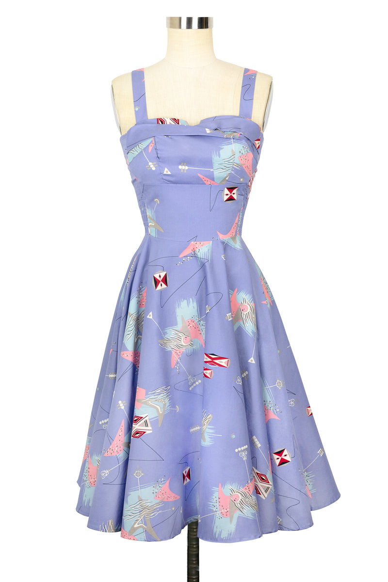 Vintage style atomic print lilac retro inspired circle skirt dress with adjustable straps that can be worn as a regular strap or if using the buttons can be adjusted to halter or with straps crossed in the back. The atomic print is very similar to something you would find in original 1950's 1960's barkcloth