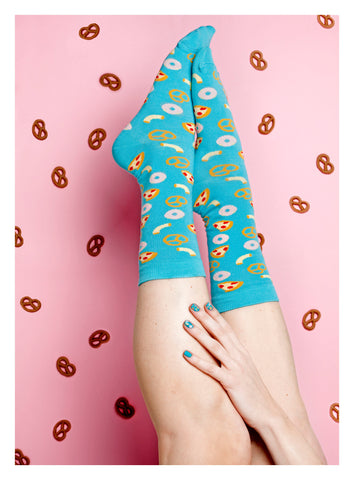 Colourful, funky socks covered in donuts and pretzels