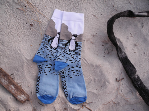 Men's blue penguin socks by FEAT. socks. Designed and made in Cape Town