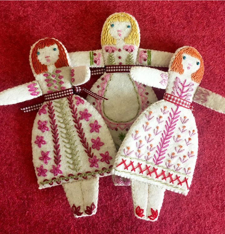 Three little folk dolls