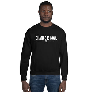 Our Change is Now is black sweatshirt with our ballwalk logo. Change is Now is written in white text and our ballwalk logo is also in white.