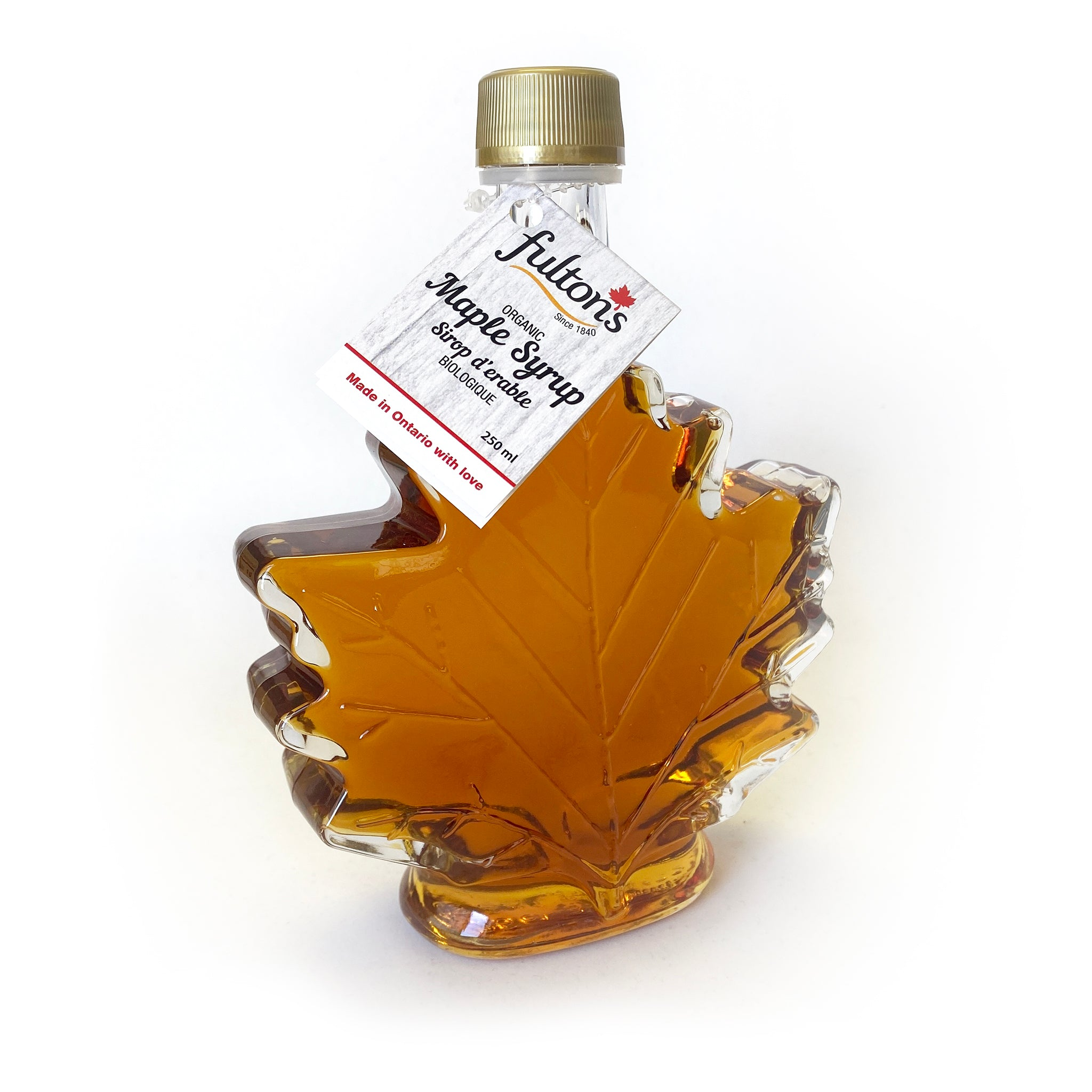 Bottle of Fulton's maple syrup shaped like a maple leaf.
