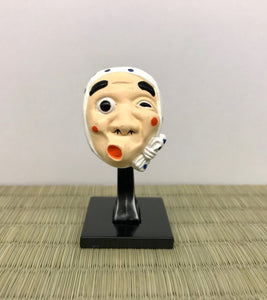 hyottoko mask with a stand