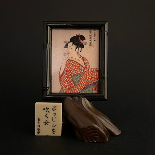 """Young woman blowing a glass pipe"" by utamaro"